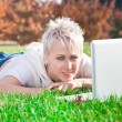 Smiling girl using laptop — Stock Photo #11932517