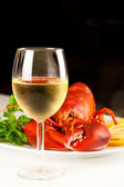 Glass of white wine with cooked lobster — Stock Photo