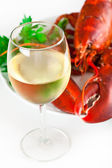 Glass of white wine with lobster — Stock Photo