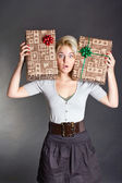 Surprised pretty woman holding two gift box — Stock Photo