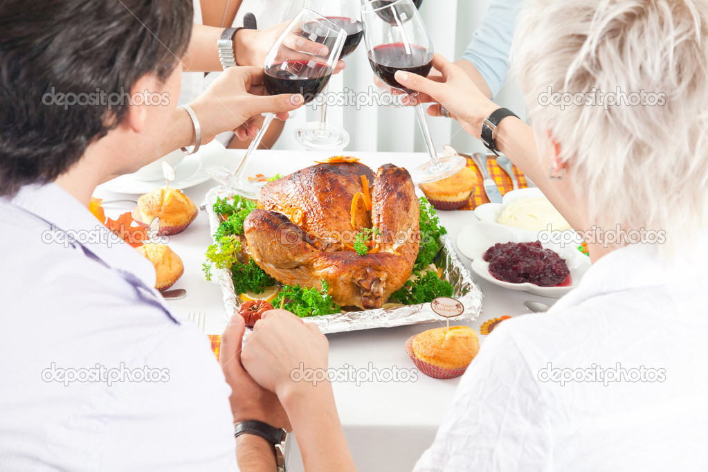 Family members giving thanks to God at festive table while holding each other by hands, close-up — Stock Photo #11932305