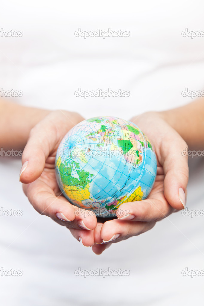 Hands holding the world on a white background  Stock Photo #11932378