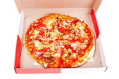 Excellent pizza in box with mozzarella, ham, pork, pickled peppe — Stock Photo
