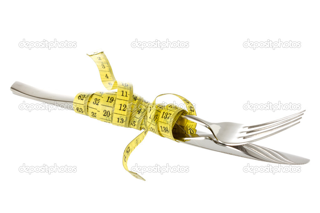 Fork and knife wrapped by measure tape. Isolated on white background — Stock fotografie #10955008