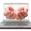 Open palms coming out of a laptop - Foto Stock