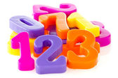 Colorful assorted plastic numbers — Stock Photo