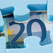 Blue puzzle on Euro currency — Stock Photo