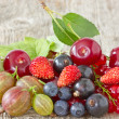 Stock Photo: Assorted berries on wooden floor