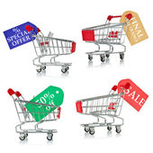 Shopping carts with tags of discount and sale — Stock Photo