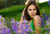 Beautiful girl on green field — Stock Photo