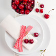 Decoration with fresh flowers and sweet cherry - Foto Stock
