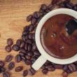 Black coffee and coffee beans - Stockfoto