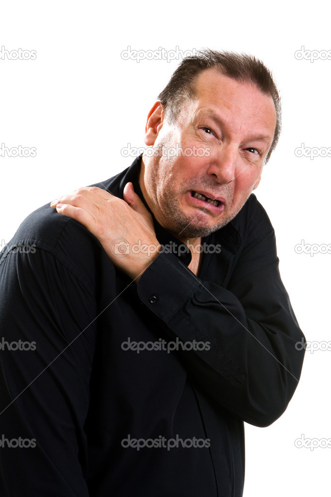 Elderly man suffering with a hurting shoulder rubs it with his hand and makes a painful expression. — Stock Photo #11623720