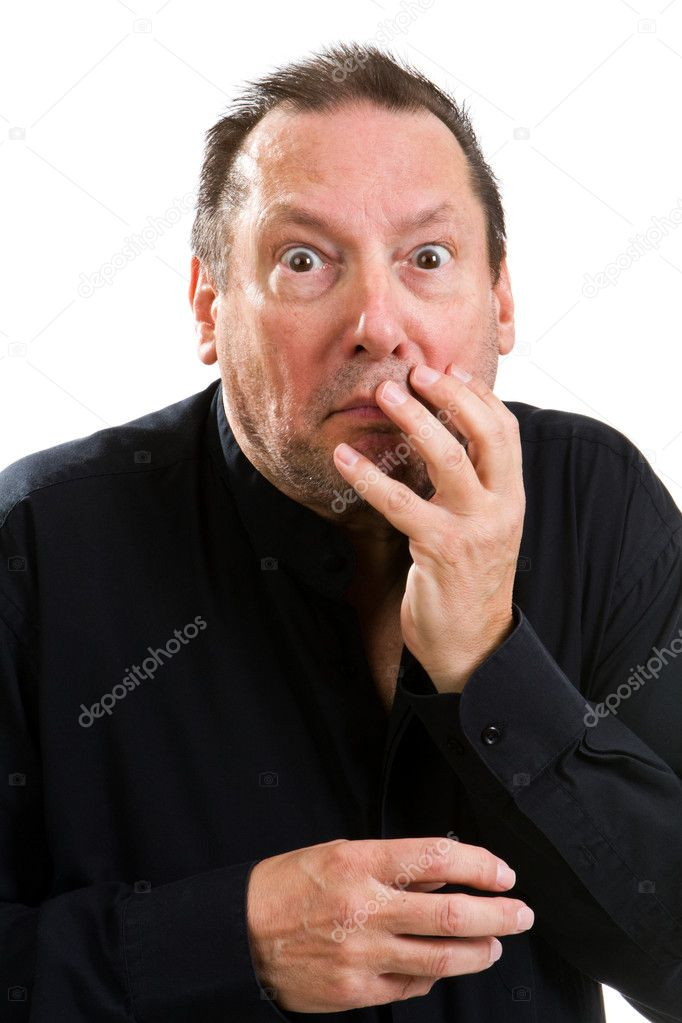 Elderly psychopathic man with a wild eyed look in his eyes holds his face with an shocked expression. — Stock Photo #11762196