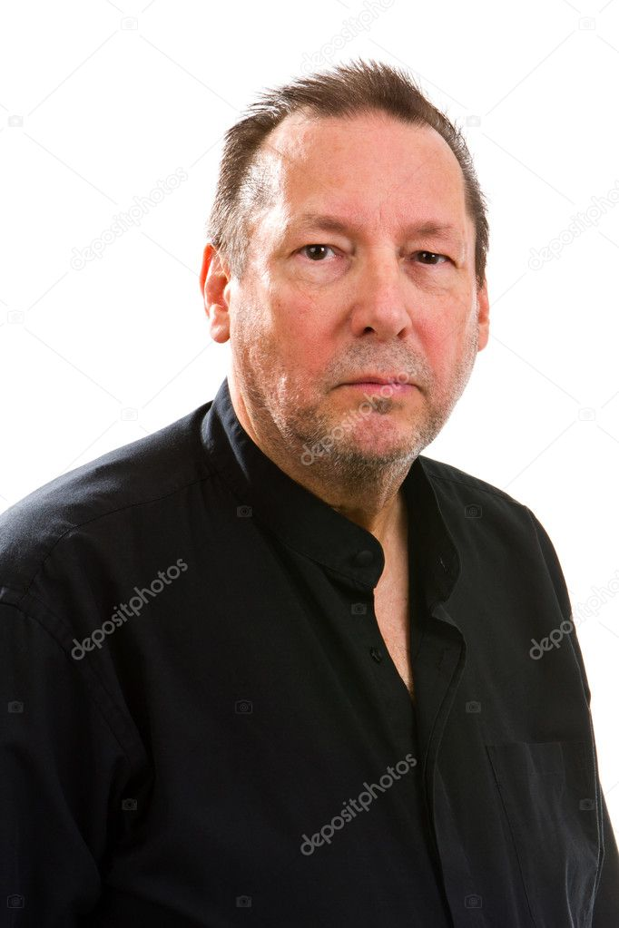 Serious elderly man in a black shirt looks into the camera with a subdued expression. — Stock Photo #11956841