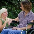 Caregiver With Patient — Stock Photo #12342348