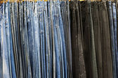 Lot of jeans — Stock Photo