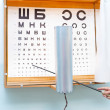 Stock Photo: Eye chart at oculist