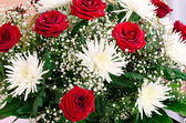 Red roses and white chrysanthemums — Stock Photo