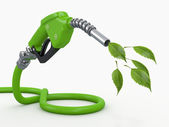 Green conservation. Gas pump nozzle and leaf — Stock Photo