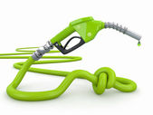 Energy crisis. Gas pump nozzle tied in a knot. — Stock Photo