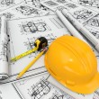 Stock Photo: Construction concept. Hardhat, blueprint and rulers.