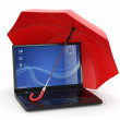 Stock Photo: Protection of information. Laptop and umbrella
