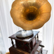 Gramophone in front of a window — Stock Photo