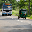 Asian regular public bus in Sri Lanka on a road - Stock Photo