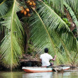 Sri Lankian fisherman in a boat on a river — Stock Photo
