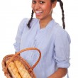 Nice multi-ethnic girl with bread in basket — Stock Photo