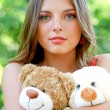 Royalty-Free Stock Photo: Pretty caucasian young woman with toys