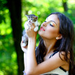 Stock Photo: Pretty young caucasigirl with cute little kitten