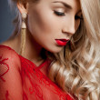 Stock Photo: Beautiful fashionable woman in red dress