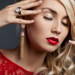 Beautiful fashionable woman in red dress — Stock Photo #11457254