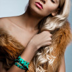 Beautiful fashionable woman with art visage — Stock Photo #11457261