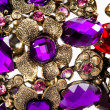 Close-up of violet and red bracelet — Stock Photo #11457263