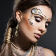 Stock Photo: Fashionable womwith art visage