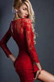 Beautiful fashionable woman in red dress — Stock Photo