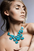 Beautiful fashionable woman with jewellry — Stock Photo