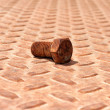 Stock Photo: Rusty metal plate and bolt