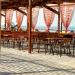 Stock Photo: Seaside restaurant tables and chairs