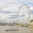 The London Eye and the Thames river — Stock Photo #11779538