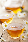 Herbal tea with chamomile flowers — Stock Photo