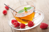 Tea with mint and berry — Stock Photo