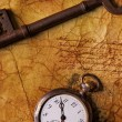 The old key with a clock on the textured paper — Stok fotoğraf