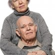 Stok fotoğraf: Portrait of a happy senior couple embracing each other
