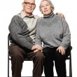 Portrait of a happy senior couple embracing each other — Stok fotoğraf