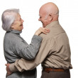 Foto Stock: Portrait of a happy senior couple embracing each other