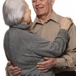 Portrait of a happy senior couple embracing each other — Stock Photo #12352756
